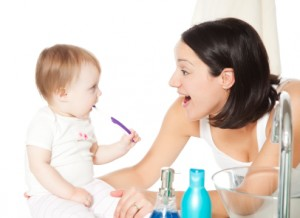 Parent caring for child's teeth