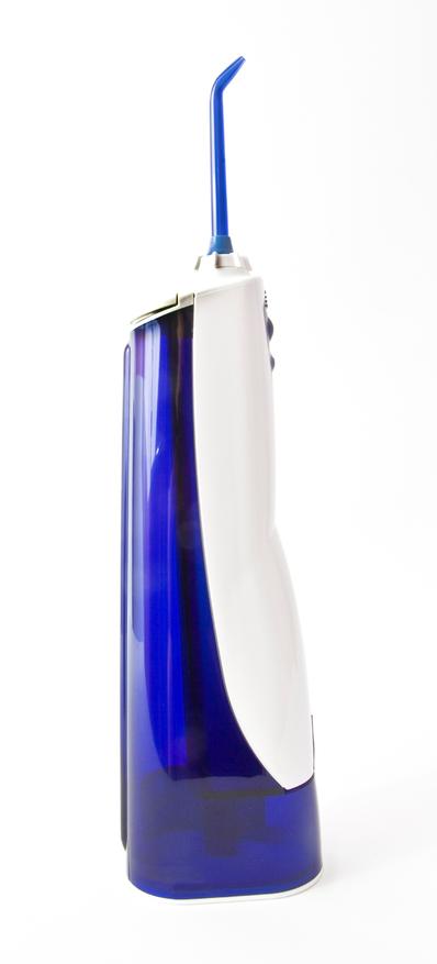 Dental care instrument-high speed water floss. Vertical.